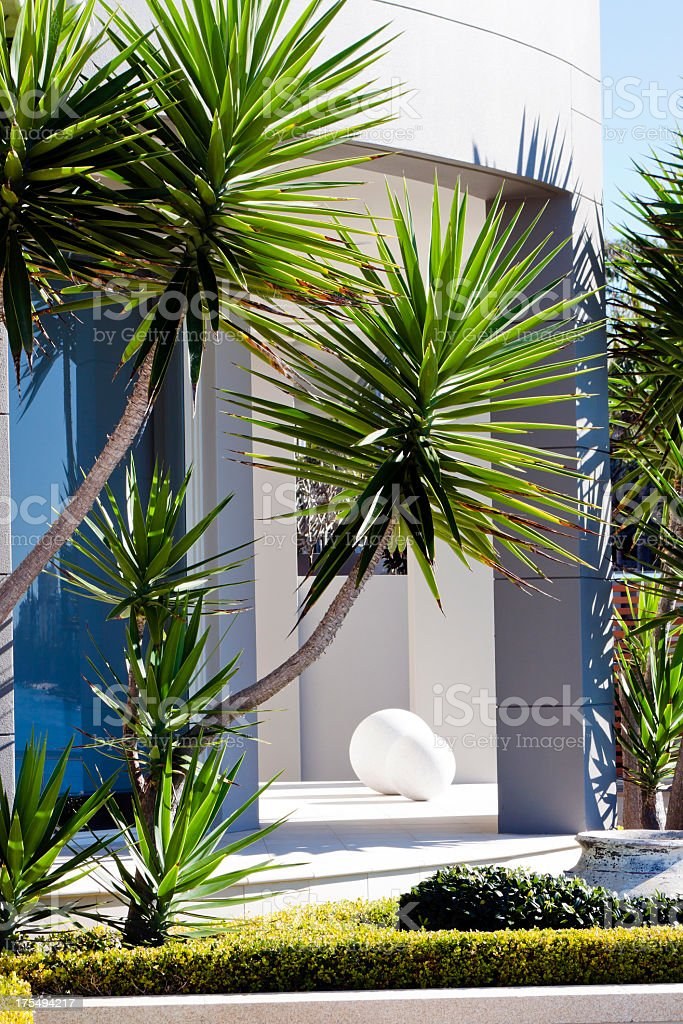 Modern house in the garden in sunlight royalty-free stock photo