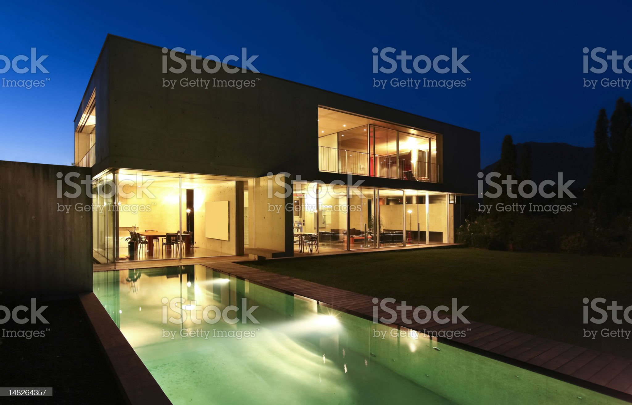 modern house outdoors at night royalty-free stock photo