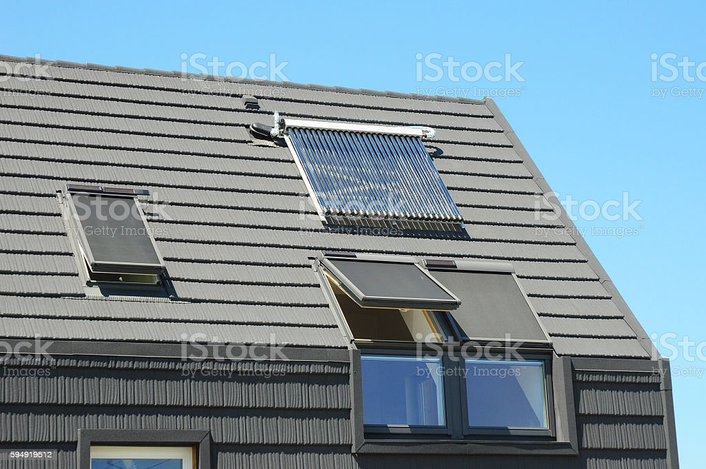 Modern House Roof with Solar Water Heater and Skylights stock photo