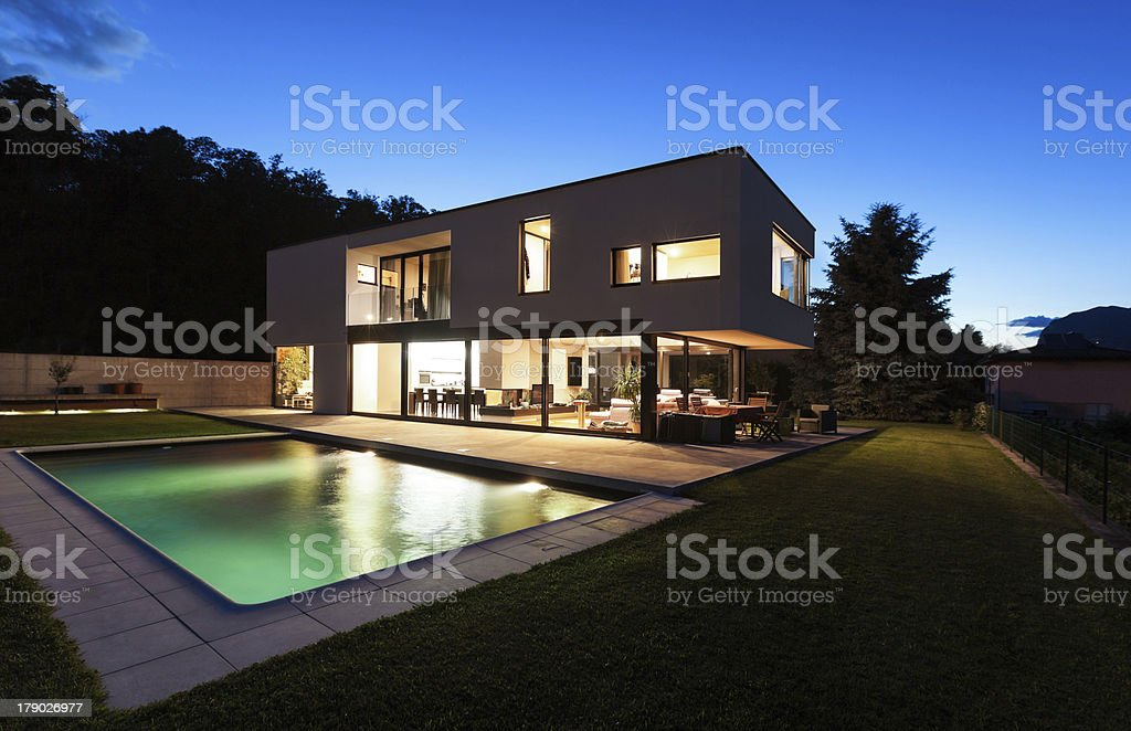 Modern house with a large pool in contemporary design royalty-free stock photo