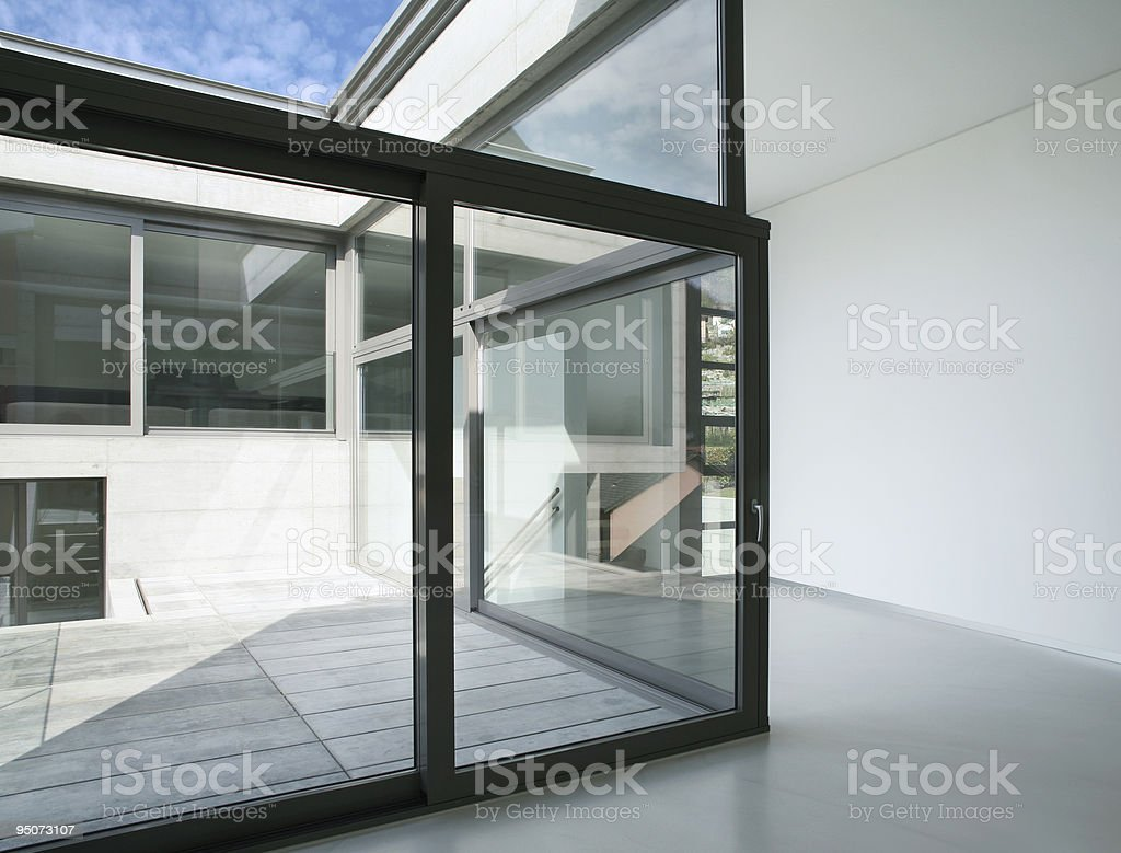 Modern house with floor to ceiling windows, white walls royalty-free stock photo