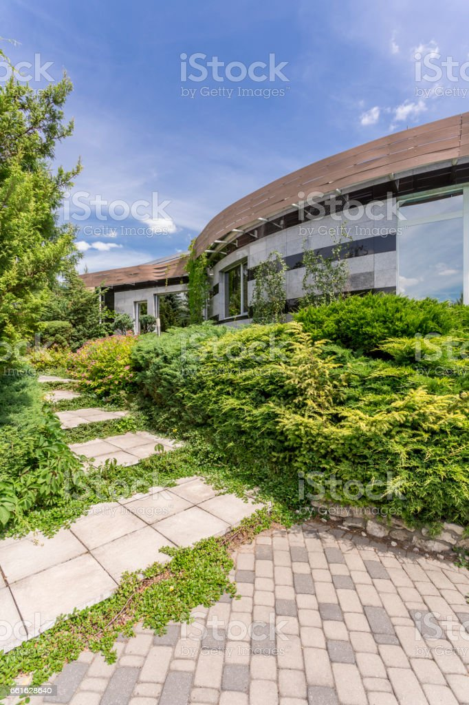 Modern housefront surrounded by plants stock photo