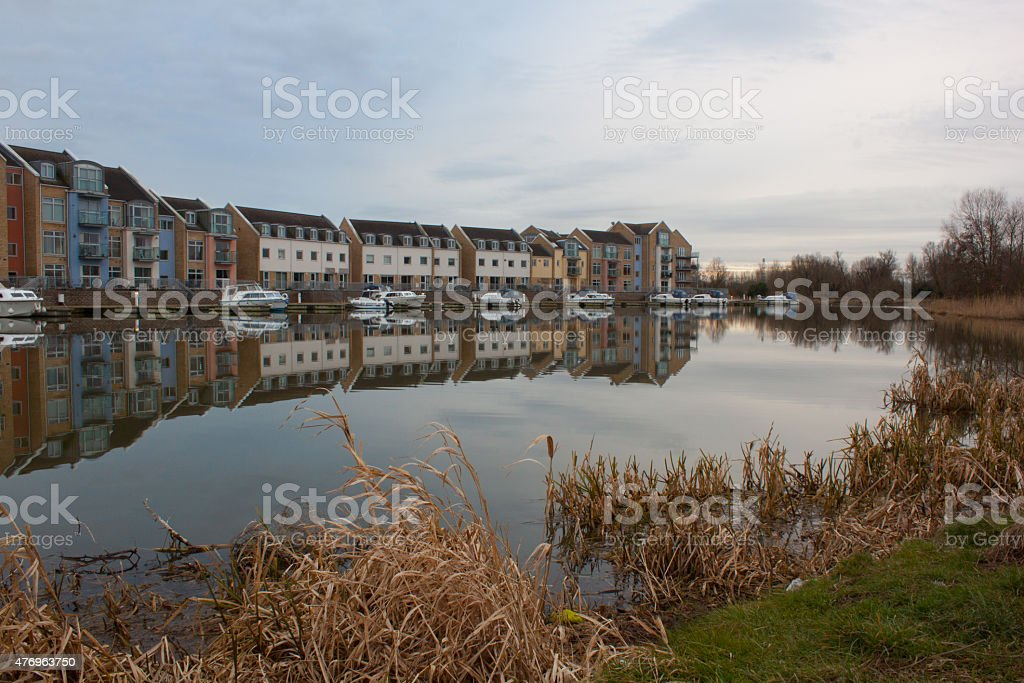 Modern houses by lake stock photo