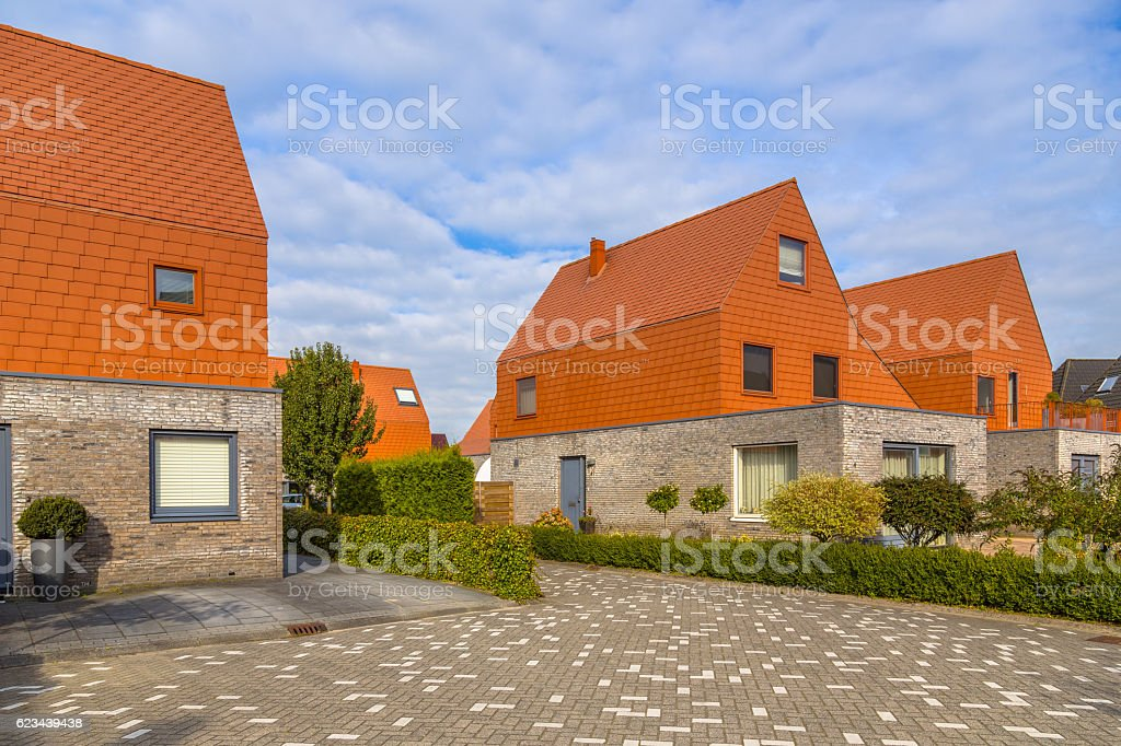 Modern houses with striking red slate roof tiles stock photo