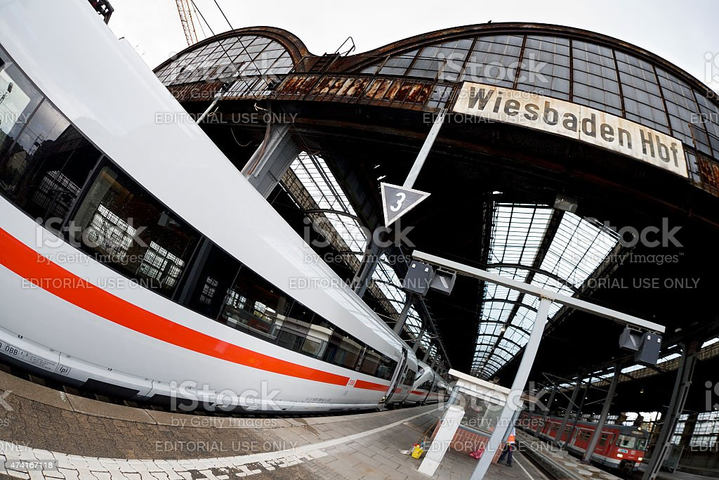 Modern ICE train and old station roof, fish-eye lens stock photo