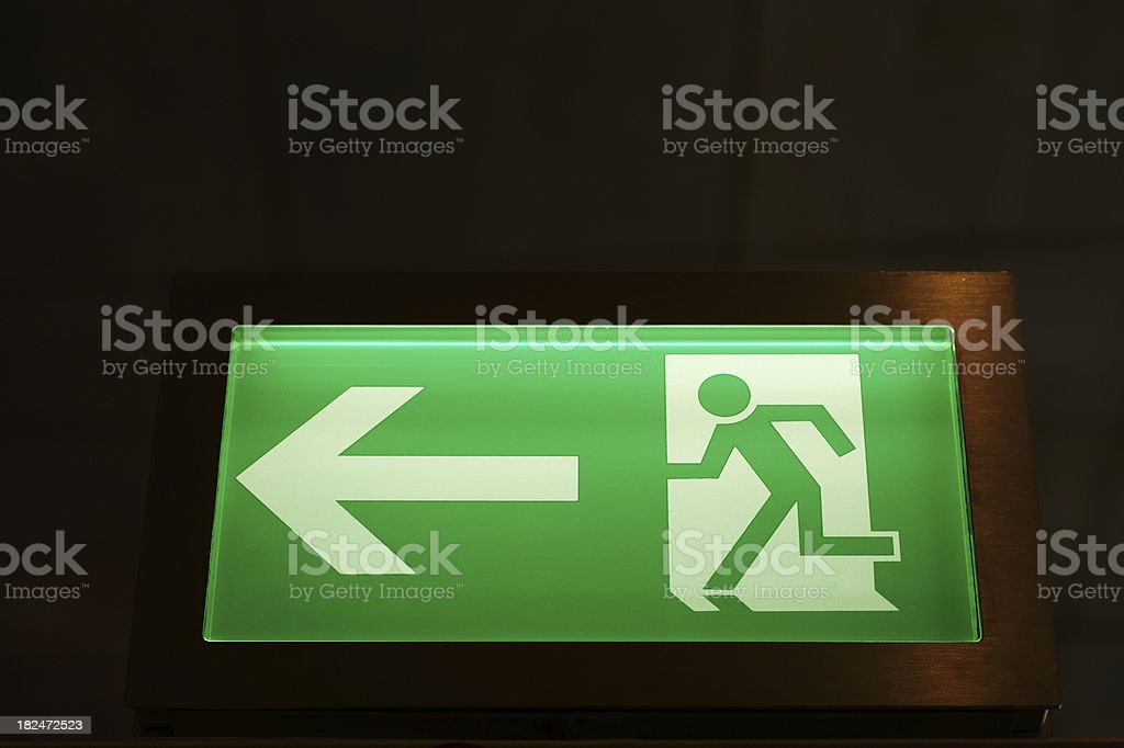 Modern Illuminated Emergency Exit Sign royalty-free stock photo