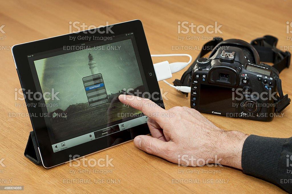 Modern image processing on iPad royalty-free stock photo