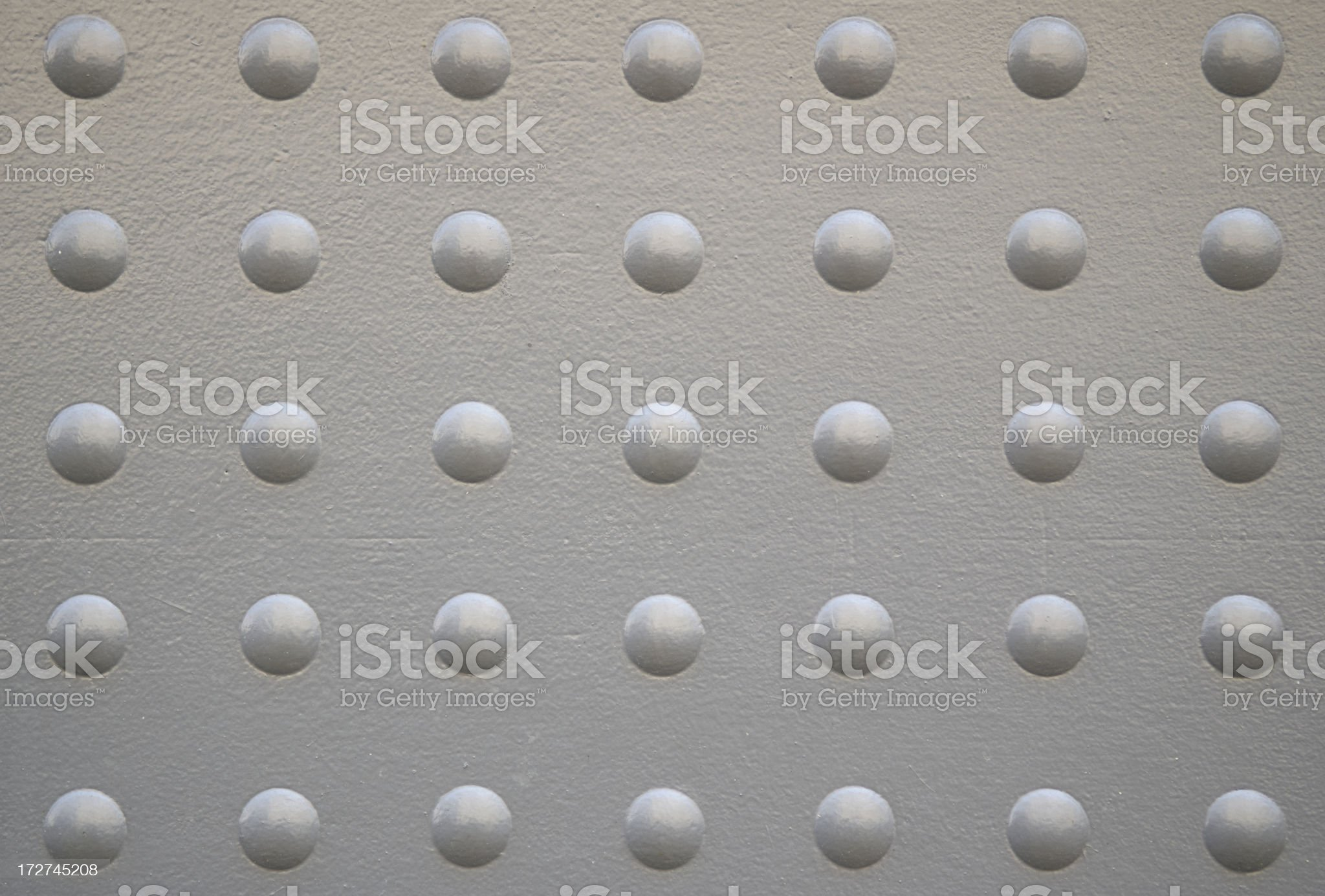 Modern Industrial Background Textured with Bubble Pattern Rivets royalty-free stock photo