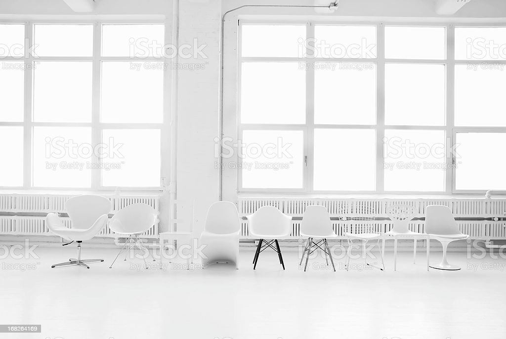 Modern Industrial Loft with a variety of chairs royalty-free stock photo