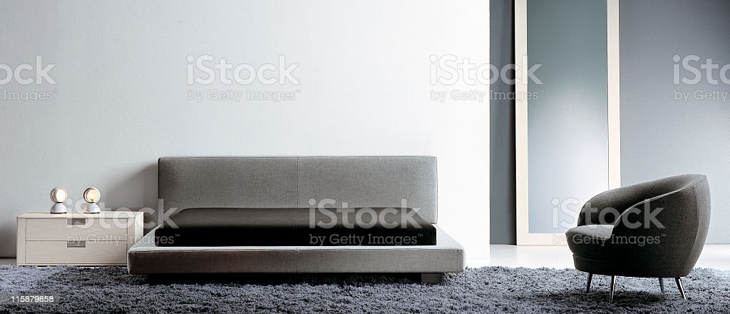 Modern interior of a bedroom in a luxury home stock photo