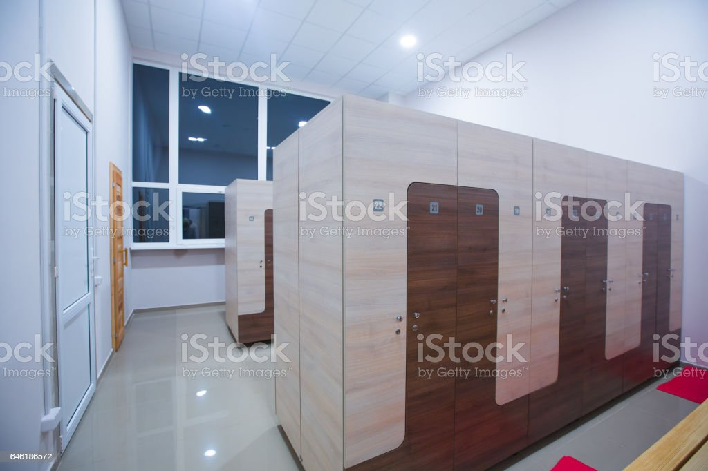 Modern interior of a locker changing room in fitness center gym stock photo