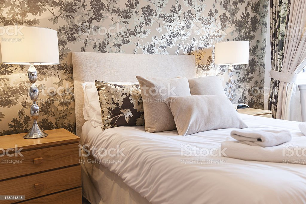 Modern interior of bedroom with floral decoration royalty-free stock photo
