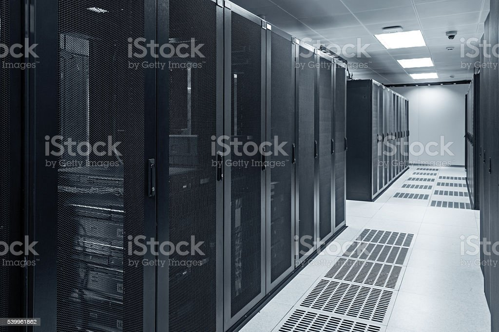 Modern interior of server room in datacenter stock photo