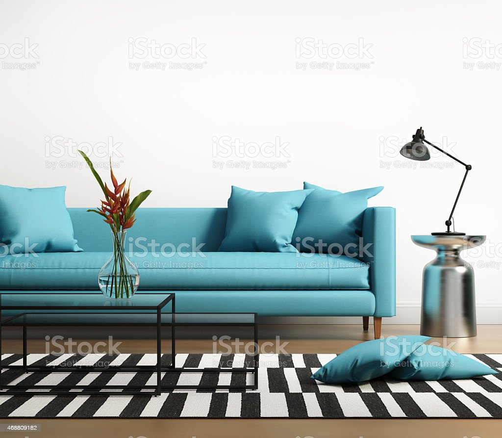 Modern interior with a turqoise sofa and striped rug stock photo