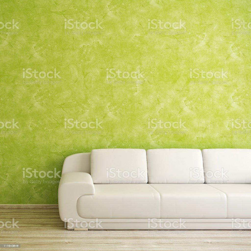 Modern interior with white sofa near green stucco wall stock photo