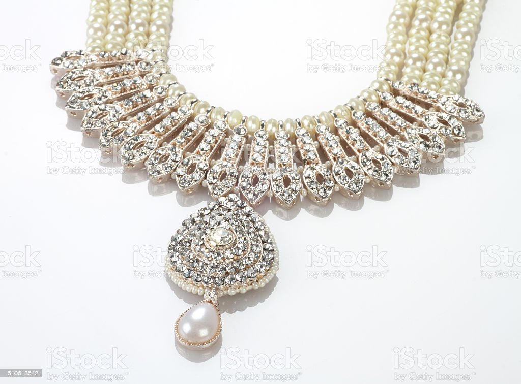 Modern Intricate Indian Jewellery Diamond Necklace on White Background stock photo