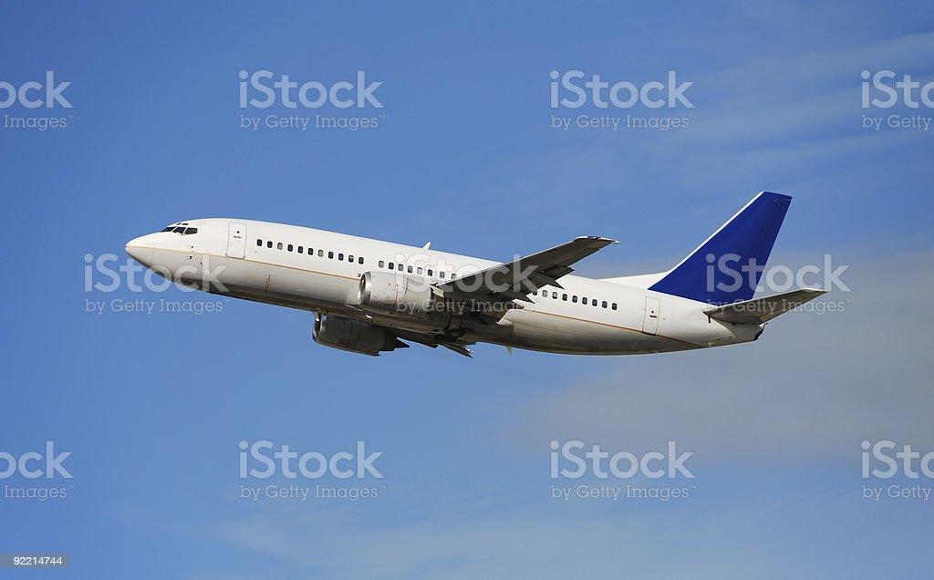 Modern jet airplane in flight stock photo