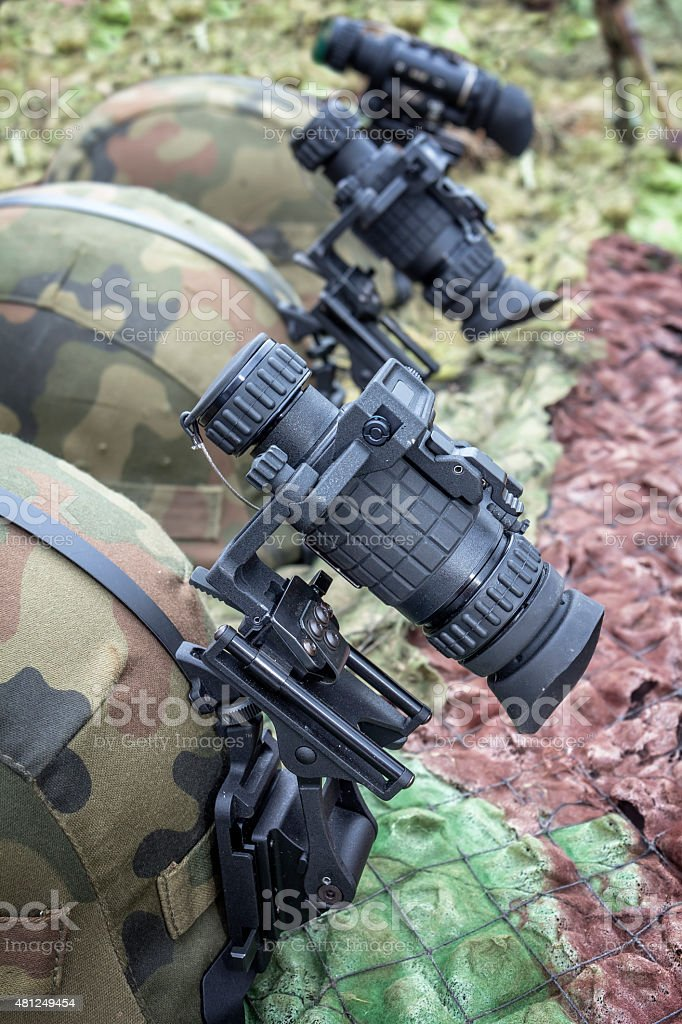 Modern kevlar helmets with night vision goggles stock photo
