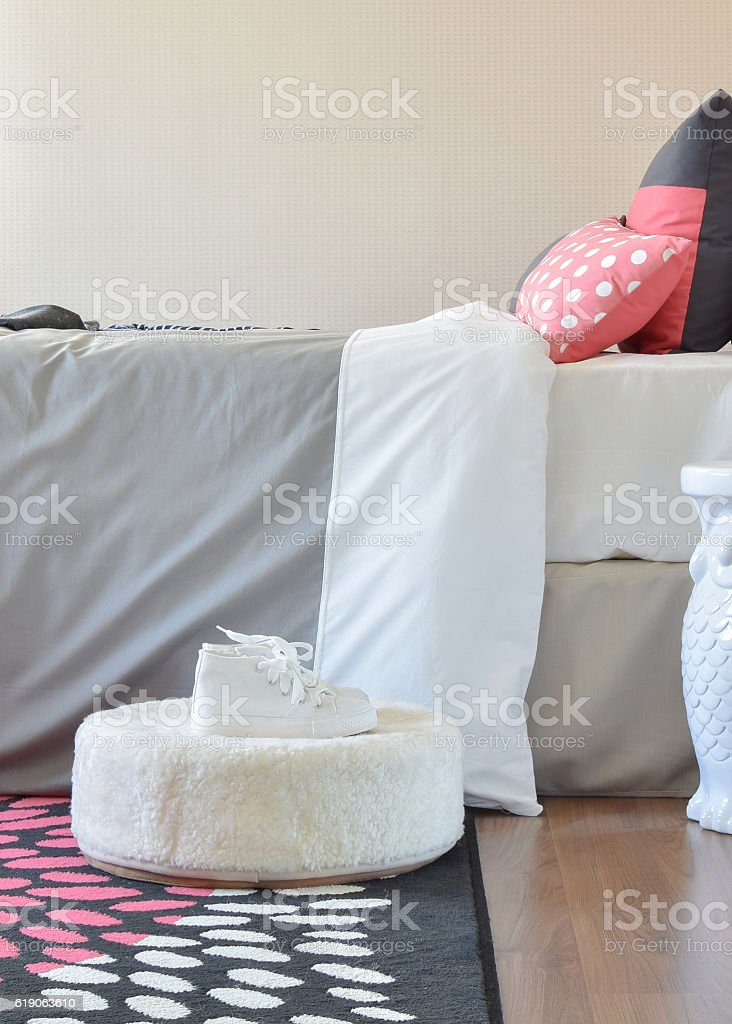 modern kids bedroom with red pillows and shoes at home stock photo