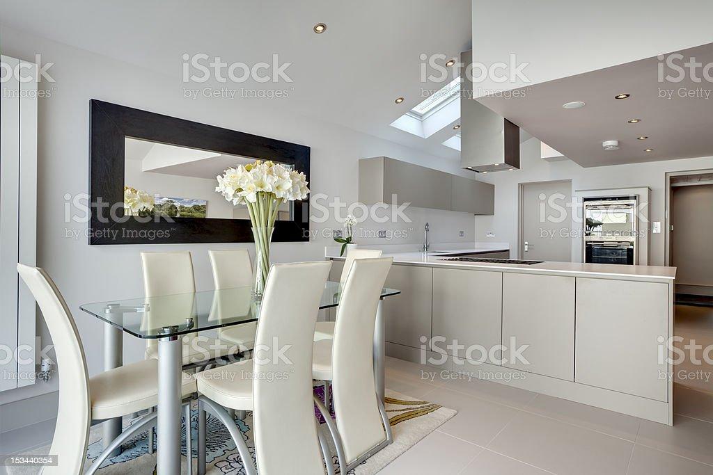 Modern kitchen and breakfast room stock photo