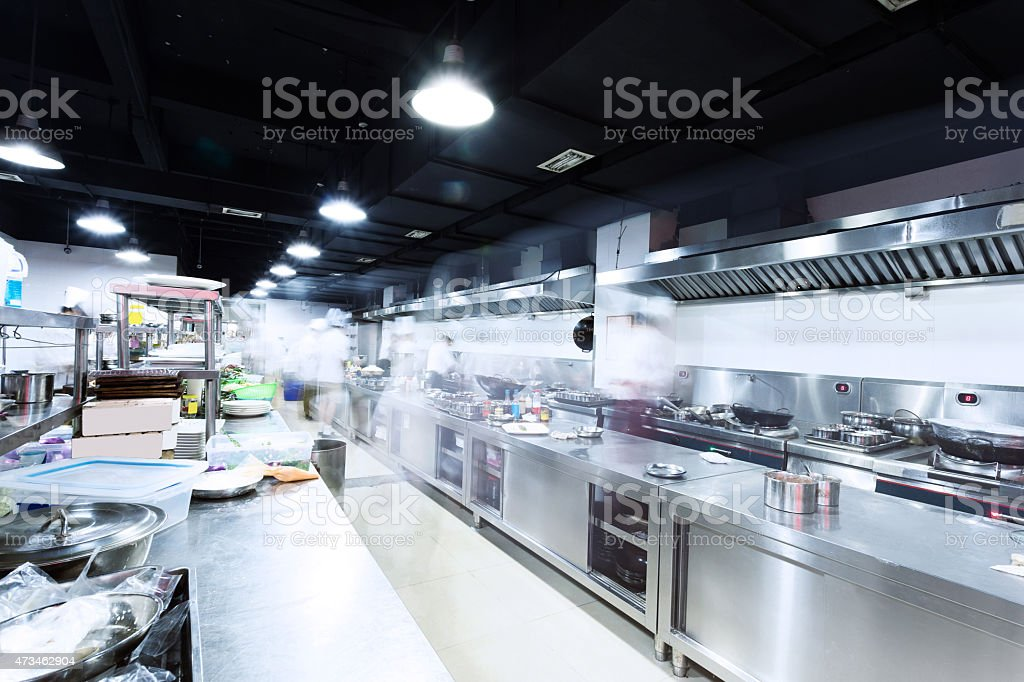 modern kitchen and busy chefs stock photo