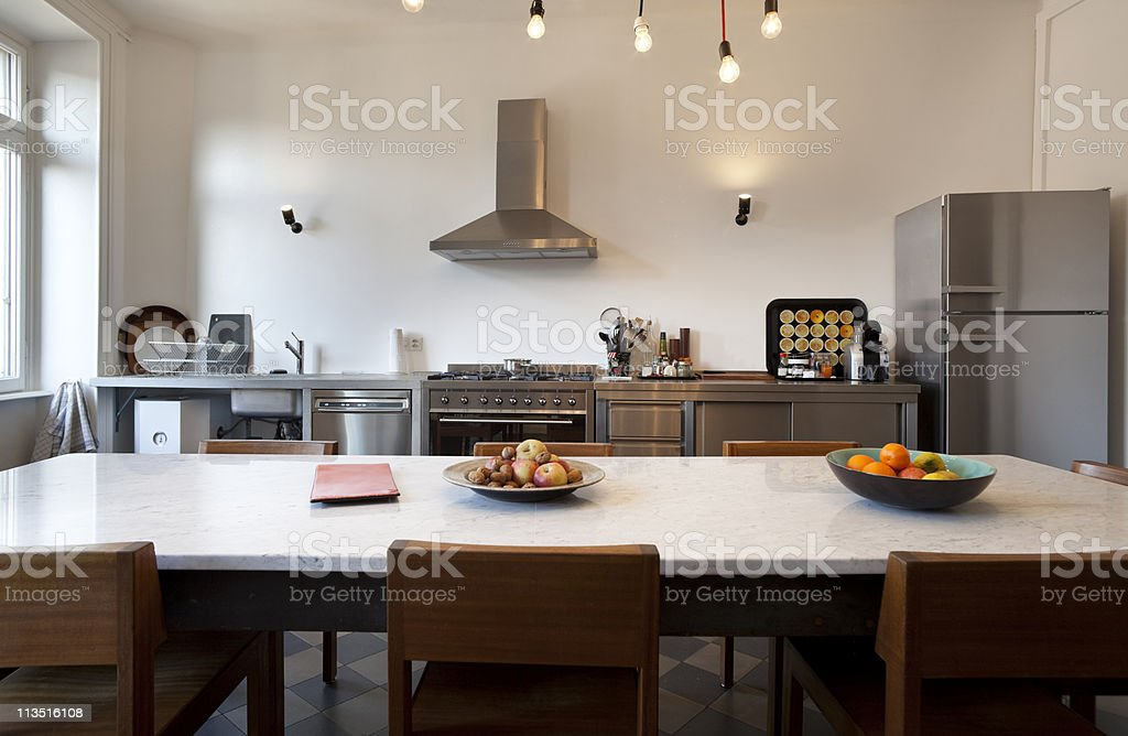 Modern kitchen and dining room combination royalty-free stock photo