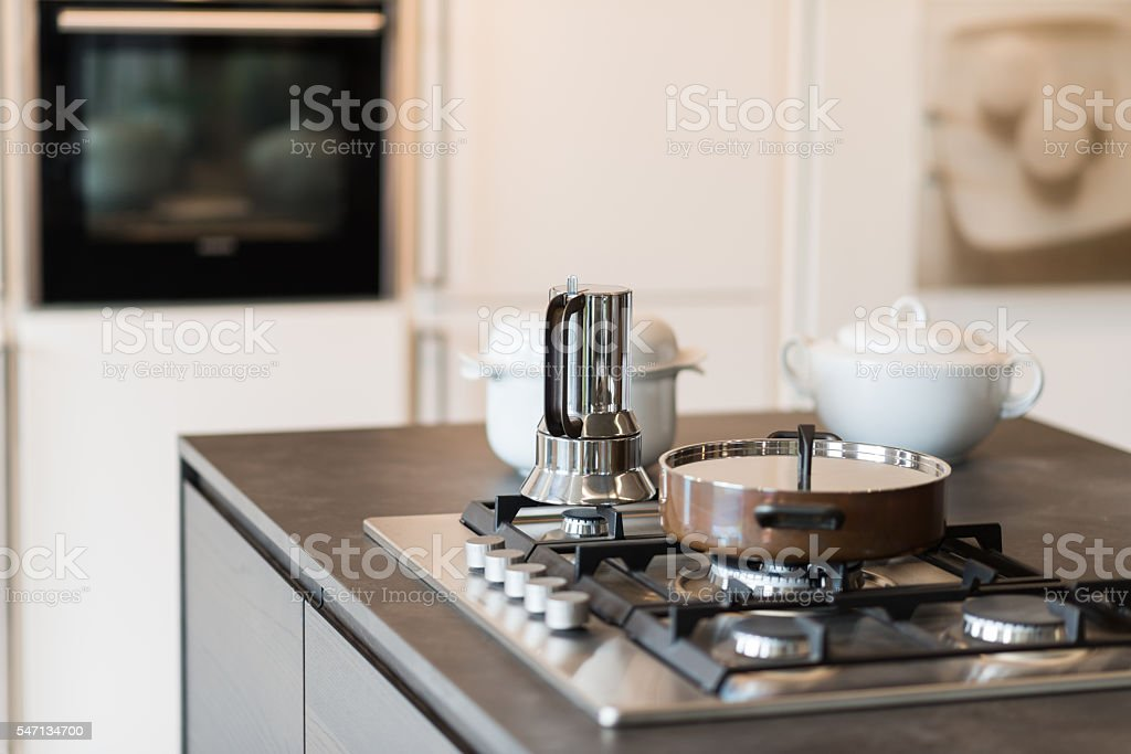 Modern kitchen burner with pot and caffettiera stock photo