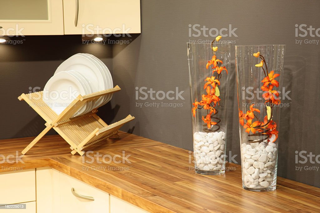 Modern kitchen decor with wood dish rack and counter royalty-free stock photo