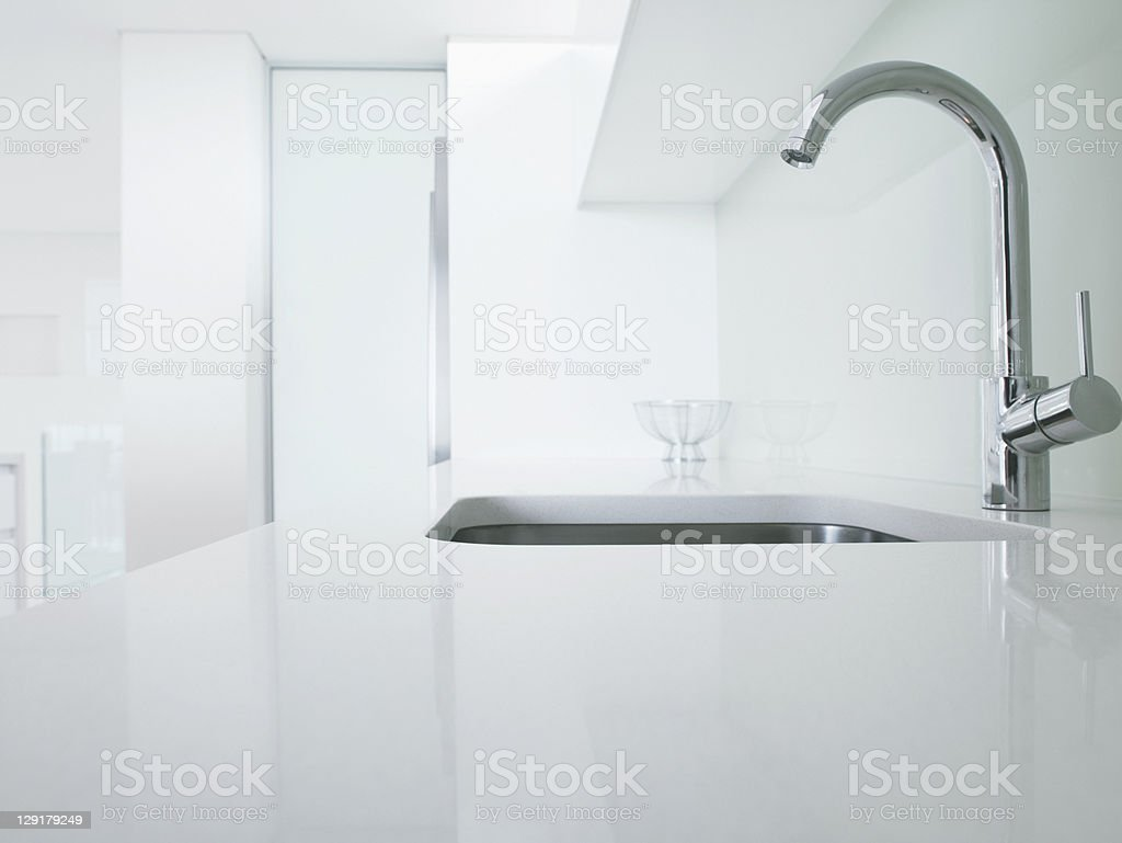 Modern kitchen faucet and sink stock photo