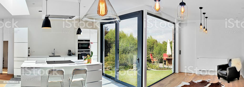Modern kitchen from loft with view on a lush garden stock photo