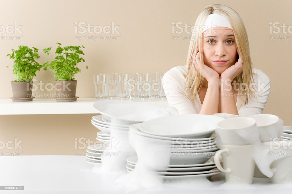 Modern kitchen - frustrated woman washing dishes royalty-free stock photo