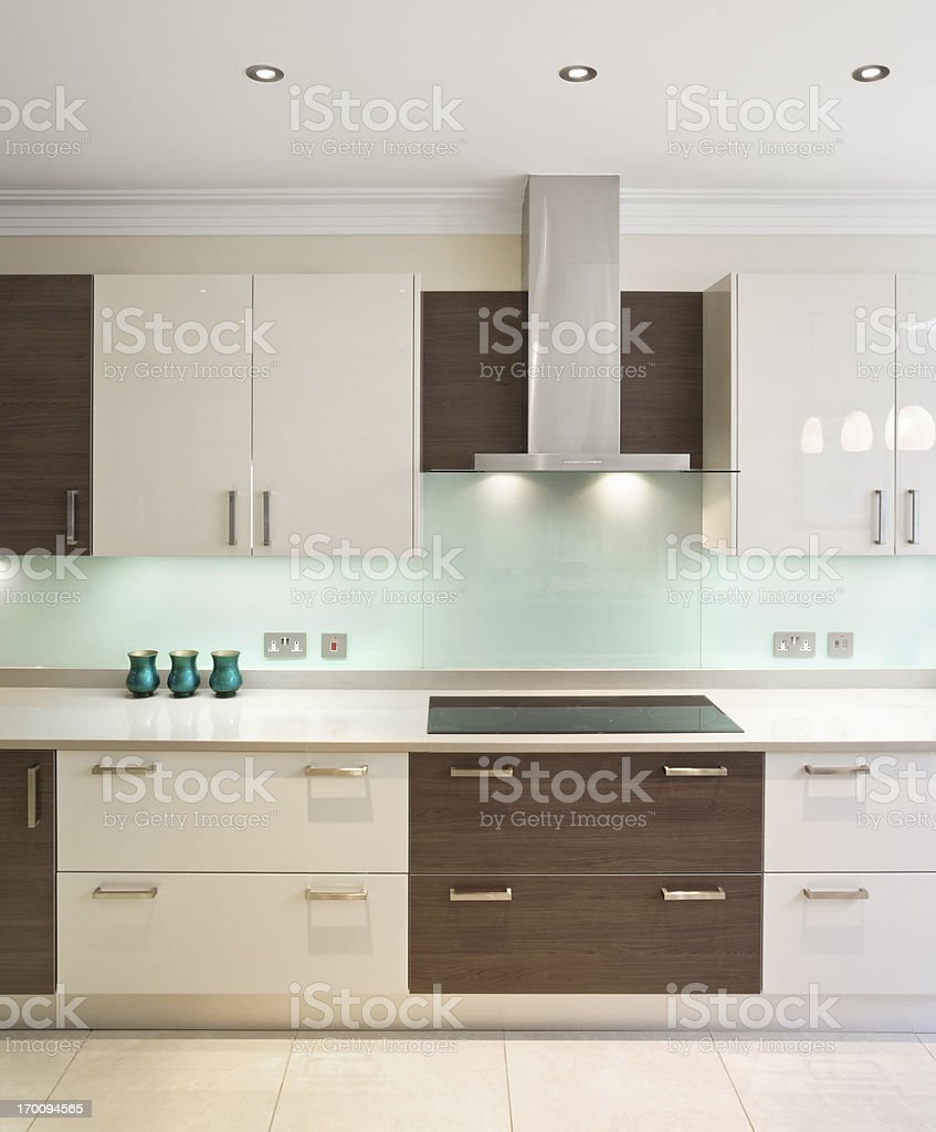 Modern kitchen in walnut and cream royalty-free stock photo