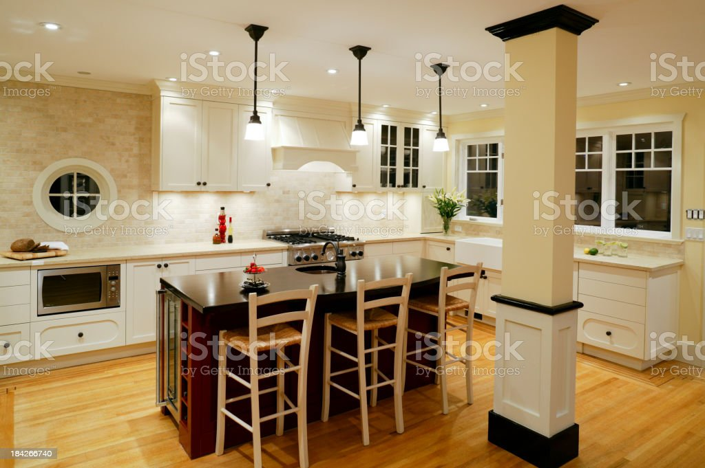 A modern kitchen interior with black and white decor royalty-free stock photo