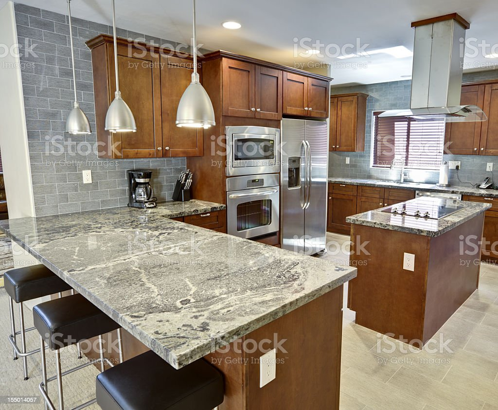 Modern kitchen interior with dark units and marble counters royalty-free stock photo