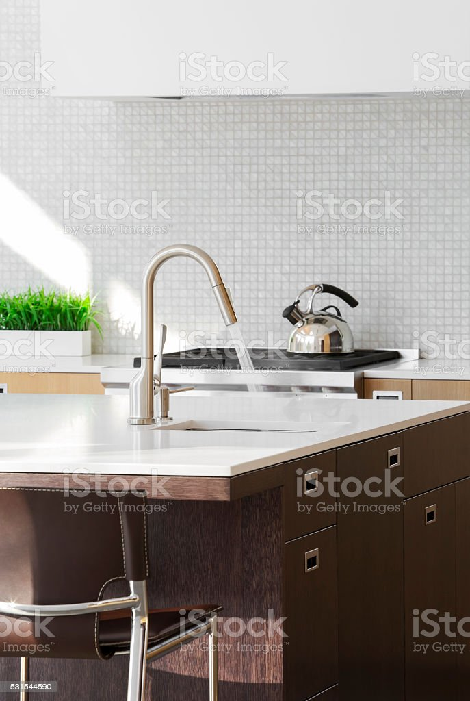 Modern kitchen island with faucet. stock photo