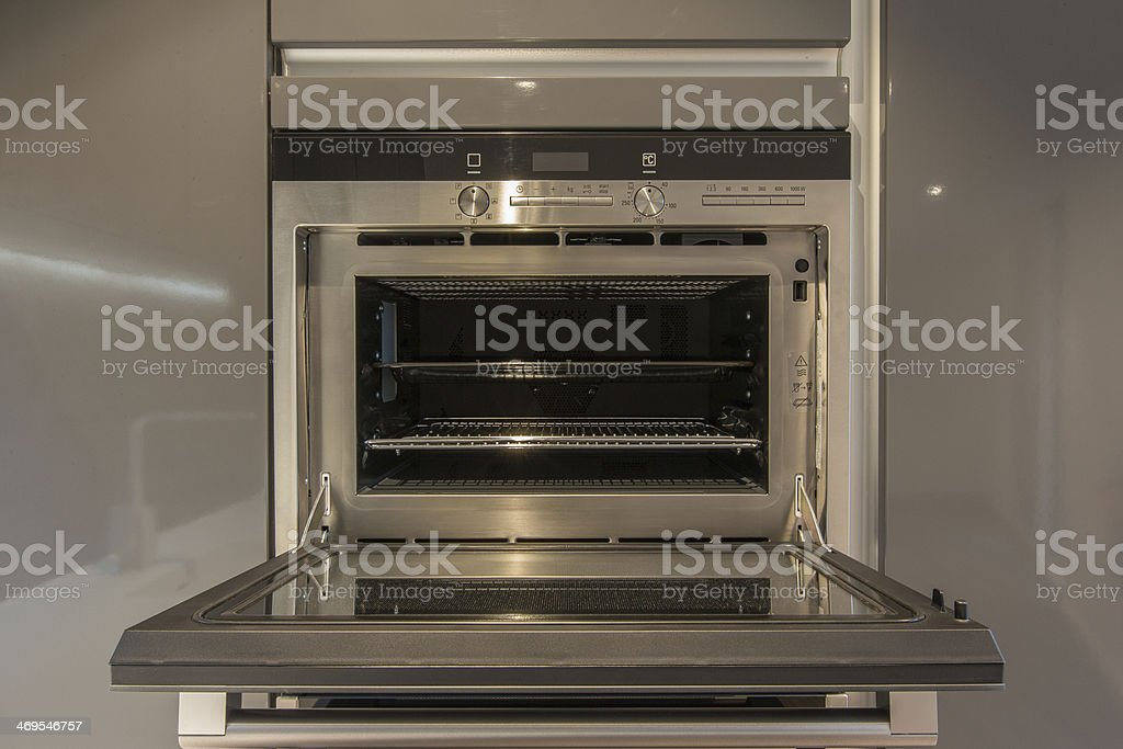 Modern kitchen oven with door open stock photo