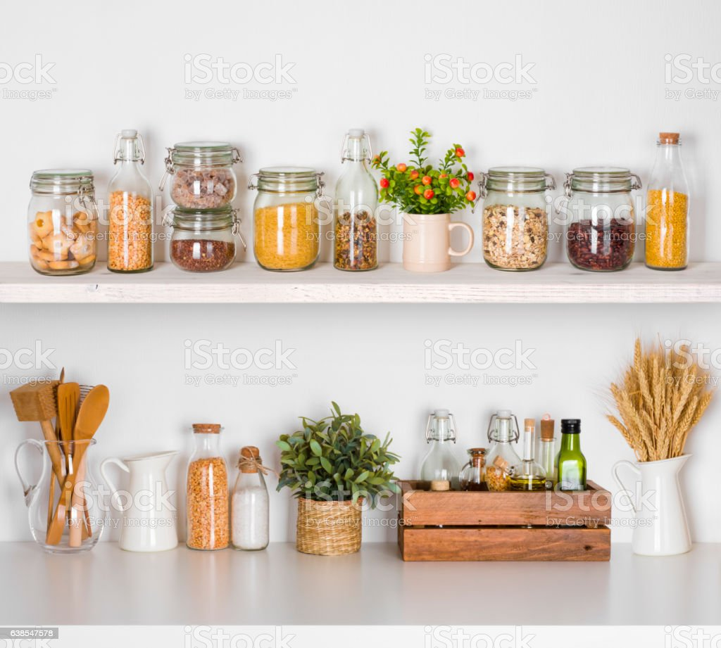 Modern kitchen shelves with various food ingredients on white background stock photo