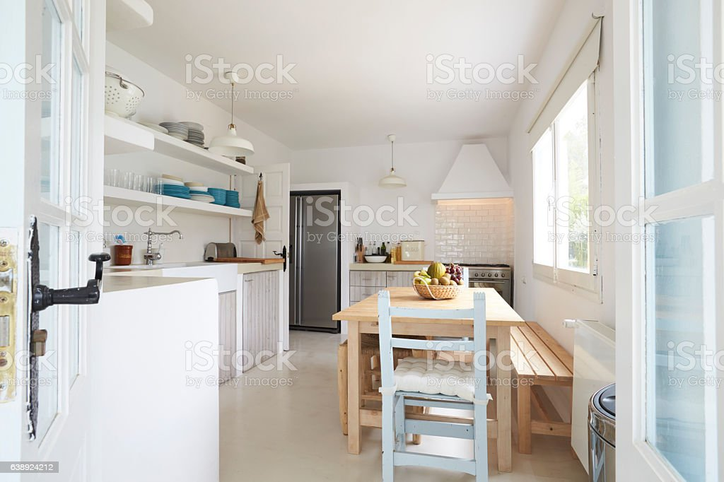 Modern Kitchen Viewed Through Open French Windows stock photo