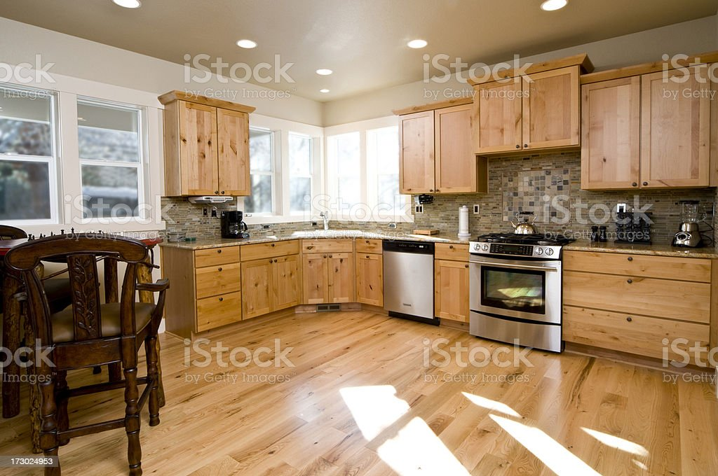 Modern Kitchen with Bricks and Hardwood royalty-free stock photo