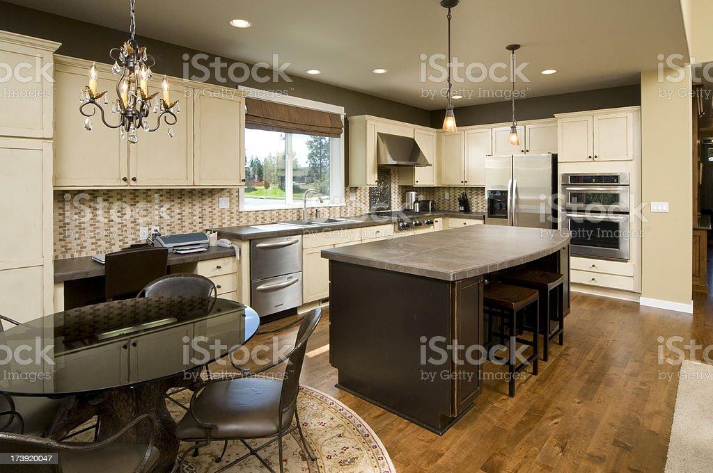Modern kitchen with dark wood island. royalty-free stock photo
