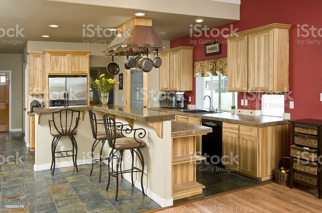 Modern kitchen with hanging pots and pans stock photo