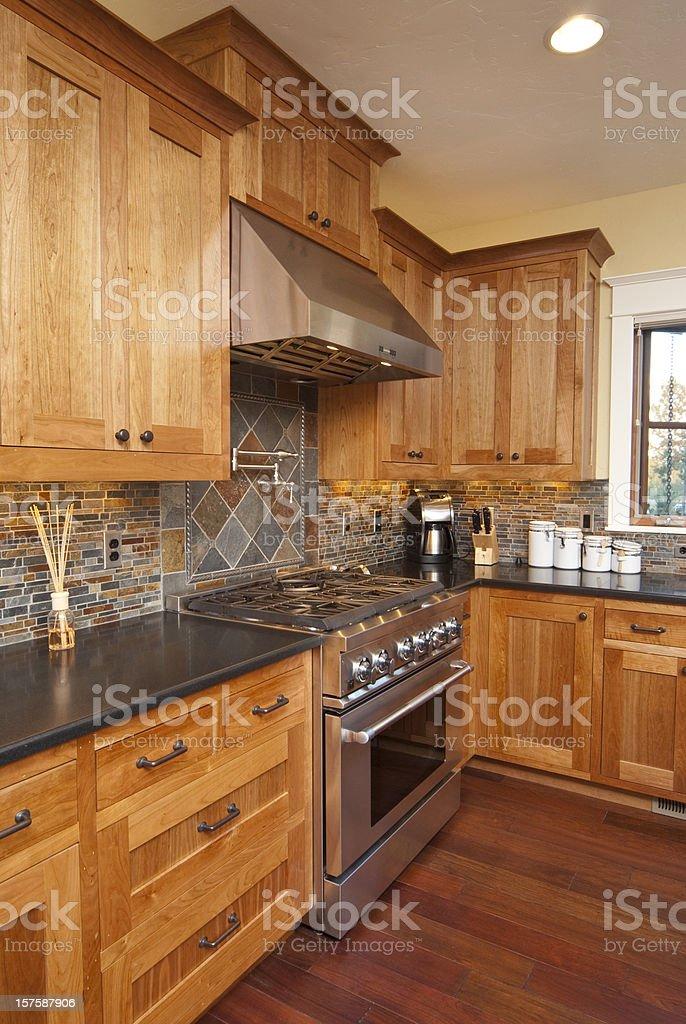 Modern kitchen with hardwood floors & stainless steel stove stock photo