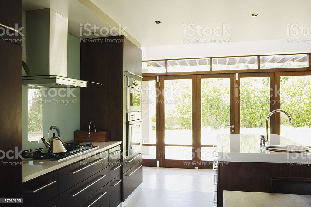 Modern kitchen with large windows stock photo