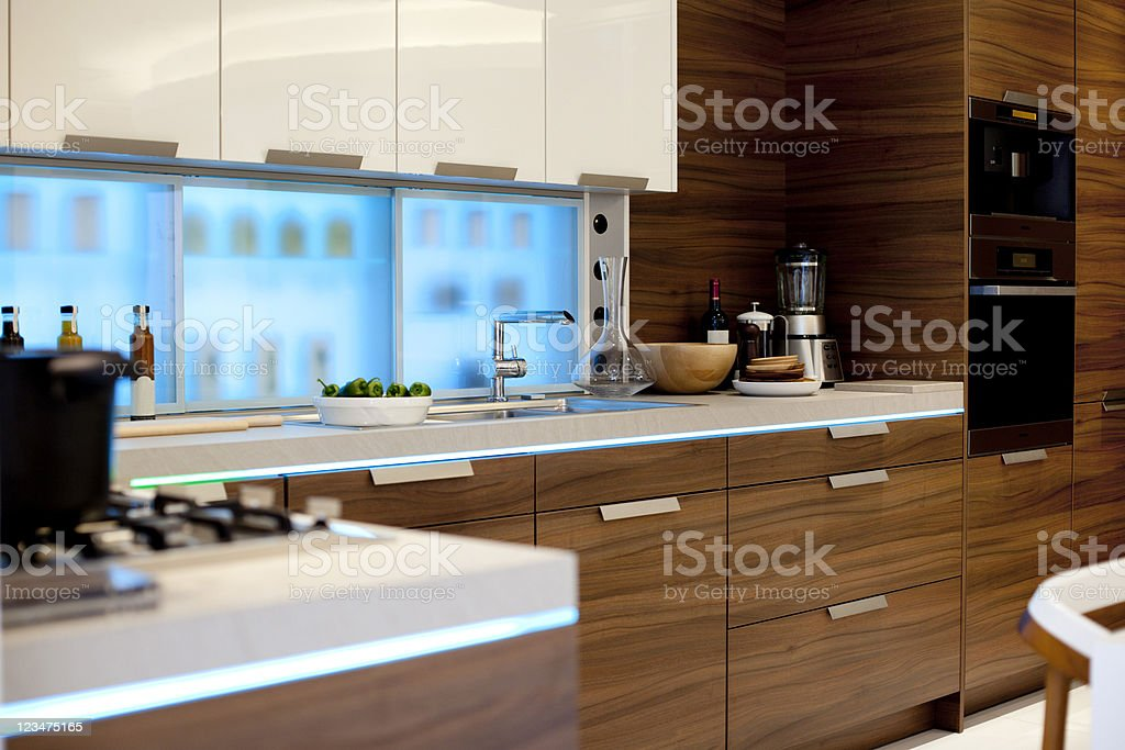Modern kitchen with natural wood cabinets royalty-free stock photo