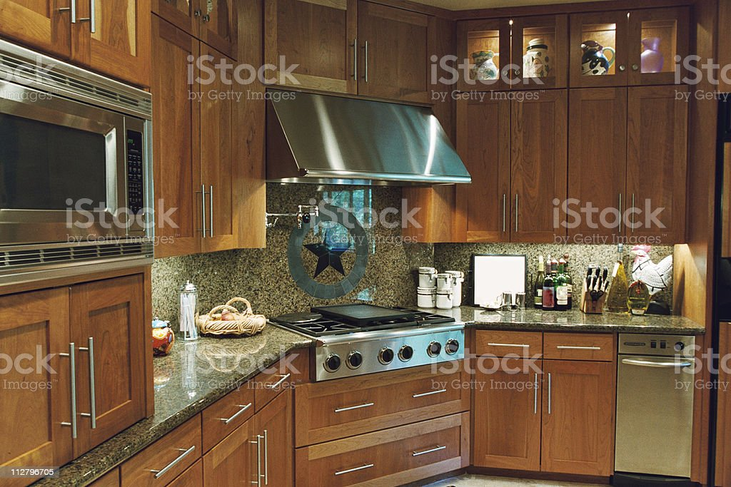 Modern Kitchen with stainless steel range and appliances stock photo