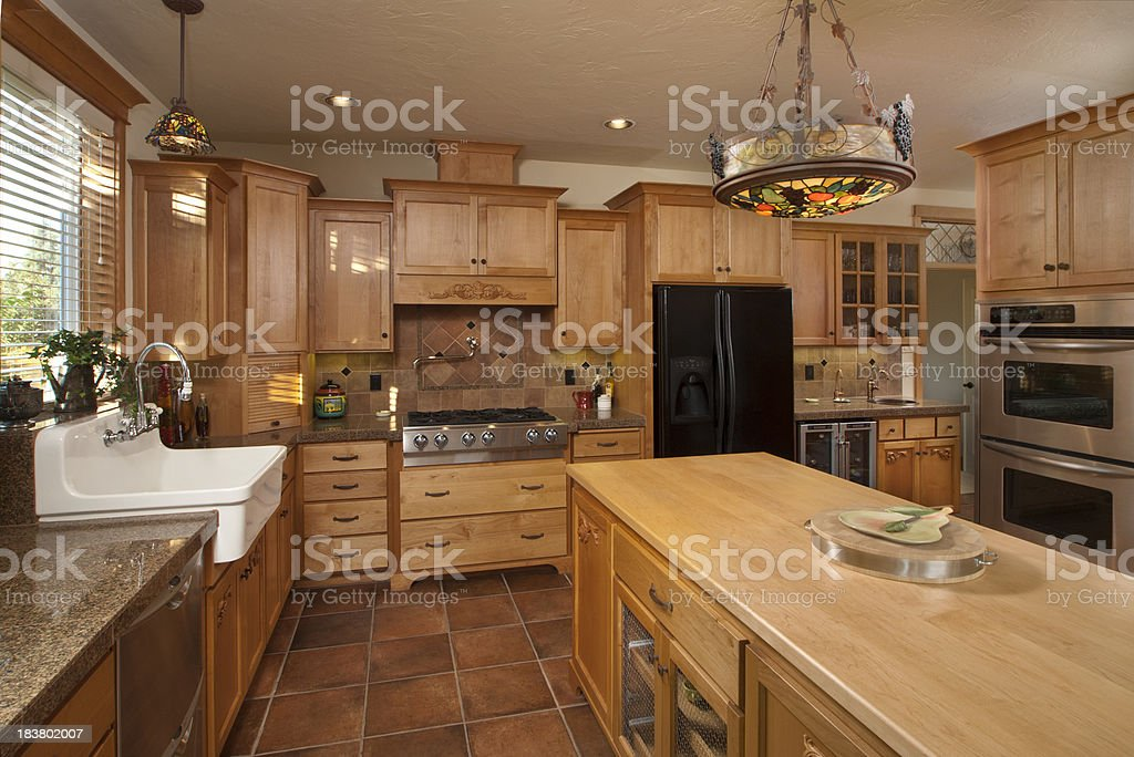 Modern kitchen with tile floor royalty-free stock photo