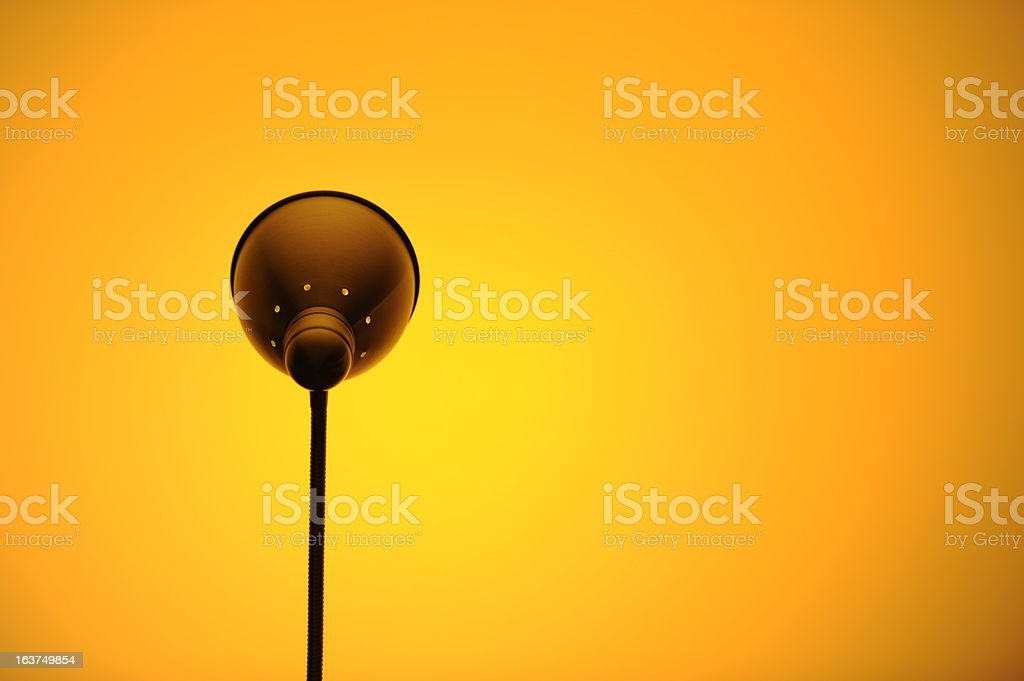Modern lamp and orange background royalty-free stock photo