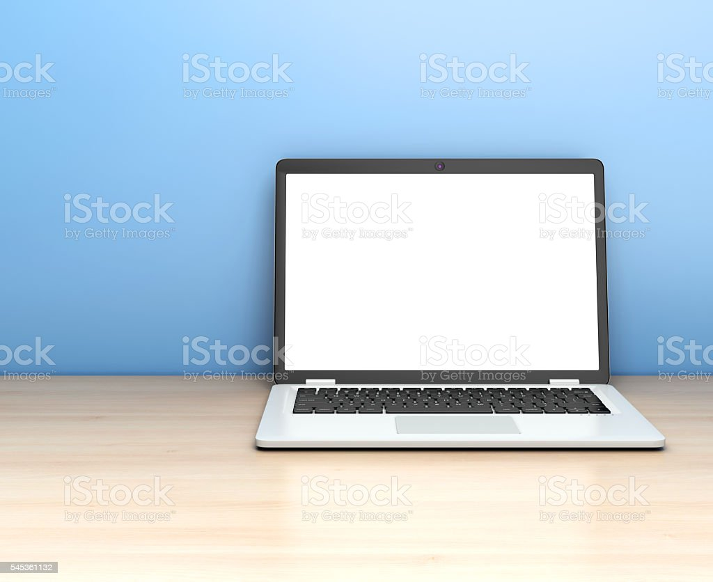 Modern laptop on table on blue background. stock photo