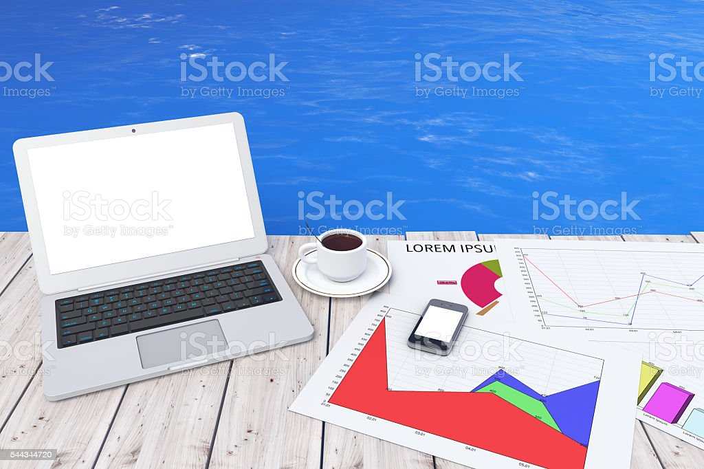Modern Laptop with Cup of Coffee and Business Graph stock photo
