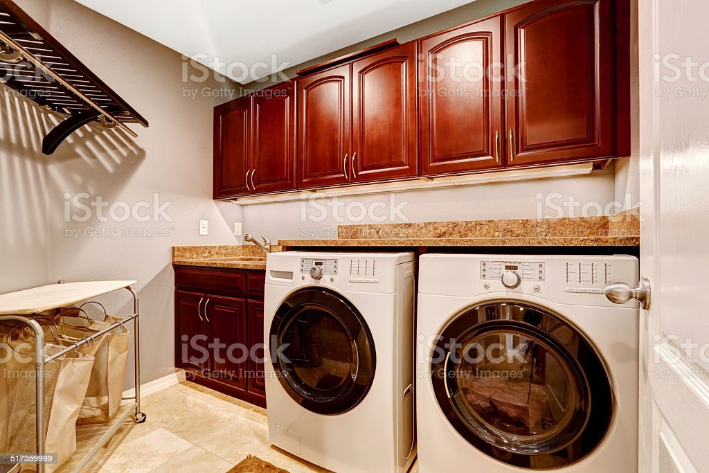 Modern laundry room with cabinets and granite top stock photo
